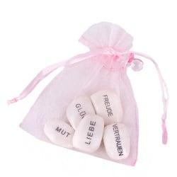 Gastgeschenk Organzasäckchen mit Gefühlssteinen und Schnuller in Rosa